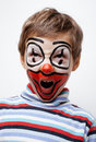 Little cute boy with facepaint like clown pantomimic expressions close up Royalty Free Stock Images