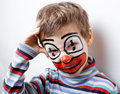 Little cute boy with facepaint like clown pantomimic expressions close up Stock Image