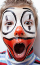 Little cute boy with facepaint like clown pantomimic expressions close up Stock Photos