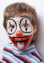 Little cute boy with facepaint like clown pantomimic expressions close up Royalty Free Stock Photography