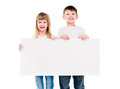 Little cute boy and girl holding an empty paper sheet Royalty Free Stock Photo