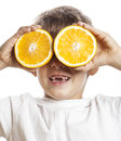 Little cute boy with orange fruit double isolated on white smiling without front teeth adorable kid cheerful Royalty Free Stock Photo
