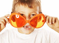 Little cute boy in orange sunglasses pointing isolated close up part of face Royalty Free Stock Photo