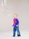 Little cute boy playing a soap bubbles kid Royalty Free Stock Image