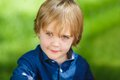 Little cute boy portrait of a on the green background Royalty Free Stock Image