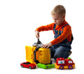Little cute boy repairing plastic toy truck white Stock Photography