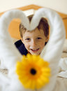 Little cute boy in room after room service towel with flower on bed Royalty Free Stock Images