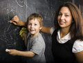 Little cute boy with teacher in classroom studying Stock Photo
