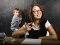 Little cute boy with teacher in classroom studying Stock Images