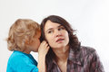 Little cute boy whispers something to his mother Royalty Free Stock Photos