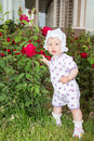 Little cute child girl with flower on nature use it for baby parenting or love concept Royalty Free Stock Images