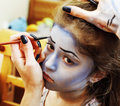 Little cute child making facepaint on birthday party, zombie Apo