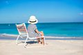Little cute girl in beach chair relax on caribbean vacation Royalty Free Stock Photo
