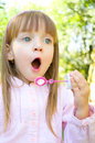 Little cute girl blowing soap bubbles Stock Photography
