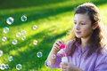 Little cute girl blowing soap bubbles outdoors summer Royalty Free Stock Photography