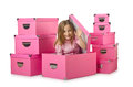 Little cute girl with boxes Stock Photo