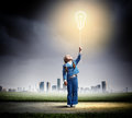 Little cute girl with bulb balloon image of holding Stock Photos