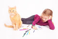 Little cute girl with colored pencils and red cat lying on the floor Royalty Free Stock Photo