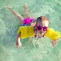 Little cute girl with diving in the sea in nice sunglasses this image has attached release Stock Image