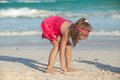 Little cute girl draws on the white sand at tropical beach this image has attached release Stock Image