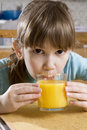 Little cute girl drink orange juice Stock Photo