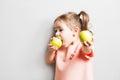 Little cute girl eating apple. inscription Go Vegan