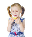 Little cute girl eating fresh lemon Royalty Free Stock Photos