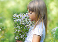 Little cute girl with flower Stock Image