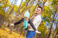 Little cute girl with happy father having fun in autumn park on a sunny day this image has attached release Stock Photo