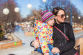 Little cute girl with her mother on sunny day outdoors walking a Stock Photography