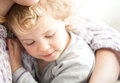 Little cute girl hugging her mother close up photo Stock Photography