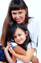 Little cute girl hugging her mother with long hair Stock Images