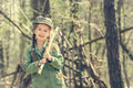 Little cute girl near her hut in the forest Royalty Free Stock Photo
