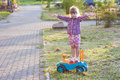 Little cute girl outdoors with a toy car on a sunny day Royalty Free Stock Photo