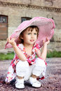 Little cute girl in pink hat Stock Image