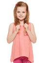 Little cute girl in a pink shirt holds hands hair, isolated on white background Royalty Free Stock Photo
