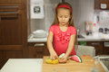 Little cute girl playing in the kitchen with fruits and vegetables this image has attached release Royalty Free Stock Photos