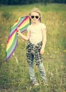 Little cute girl posing with a kite Royalty Free Stock Photo
