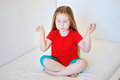 Little cute girl practicing yoga pose Royalty Free Stock Photo
