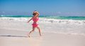 Little cute girl running on the white sandy beach in mexico this image has attached release Royalty Free Stock Image