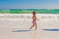 Little cute girl running on the white sandy beach in mexico this image has attached release Stock Photos