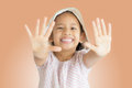 Little cute girl showing hers palms isolated smiling and Stock Photo