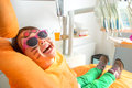 Little cute girl sitting in chair at dentist with sunglasses