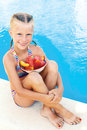 Little cute girl sitting beside the pool Royalty Free Stock Photo