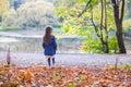 Little cute girl walks in a beautiful autumn park