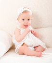 Little cute girl in a white dress and with flower smiling happy baby at home Royalty Free Stock Photography