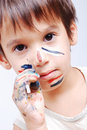 Little cute kid with colors on his face Royalty Free Stock Photo