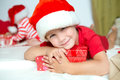 Little cute kid in santas red hat Royalty Free Stock Photo