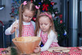 Little cute sisters bake gingerbread cookies for christmas this image has attached release Royalty Free Stock Photography