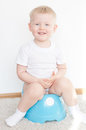Little cute smiling boy blue potty have toilet Stock Images